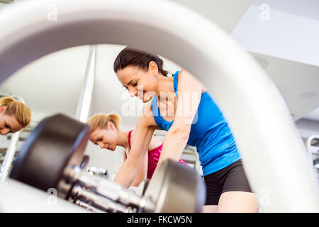 Detail of women in gym working out with weights - Stock Photo