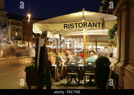 Outdoor restaurant in Piazza Navona, Rome, Italy. - Stock Photo