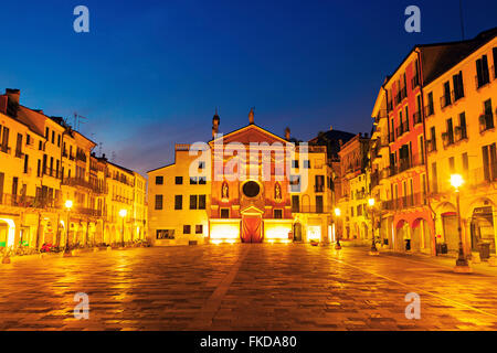 San Clemente Church on Piazza dei Signori at dusk - Stock Photo