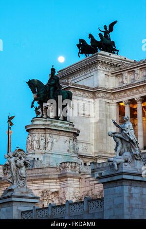 Monument of Vittorio Emanuele II against facade of building - Stock Photo