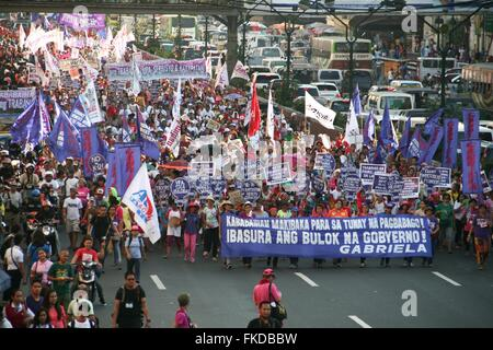 Philippines. 8th Mar, 2016. Protesters marching along Quezon Boulevard as they heaad to Mendiola, Manila. Women - Stock Photo