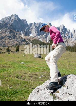 Woman hiking in Alps - Stock Photo