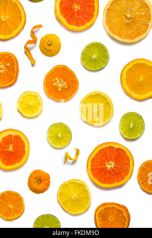 Bright colorful design of various citrus fruit slices with oranges, lemons, limes, grapefruit and tangerines. - Stock Photo