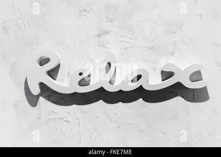 The word 'RELAX' written in wooden letterpress type. - Stock Photo