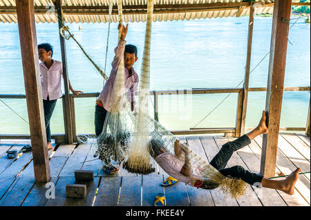 Asia. South-East Asia. Laos. Province of Champassak. 4000 islands. Don Khon. Boys playing near Mekong river. - Stock Photo