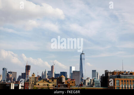 skyline of lower Manhattan including new World Trade Center and old wooden water tower - Stock Photo