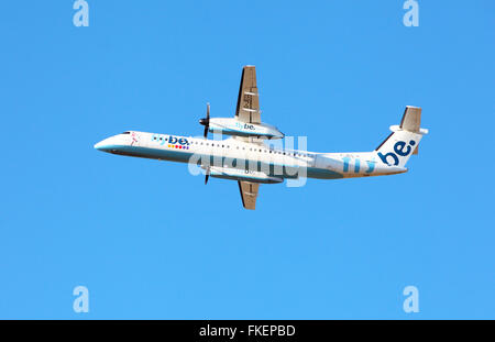Flybe leaving Edinburgh Airport - Stock Photo