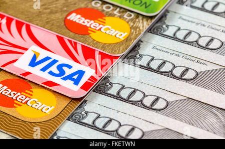 US dollar bills with credit cards Visa and MasterCard