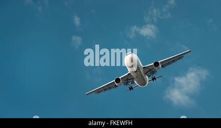 Large Commercial Airliner Coming In To Land - Stock Photo