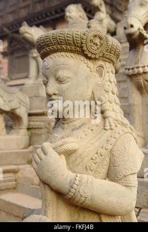 Guardians on Siddhi Lakshmi Temple, Durbar Square, Bhaktapur, Nepal - Stock Photo