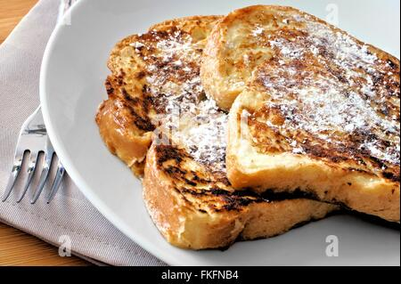 Plate of French Toast with powdered sugar close up - Stock Photo