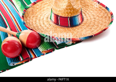 Traditional Mexican serape blanketor rug with sombrero and maracas isolated against a white background.  Space for - Stock Photo