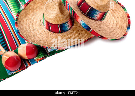 Traditional Mexican serape blanket or rug with sombreros and maracas isolated against a white background.  Space - Stock Photo