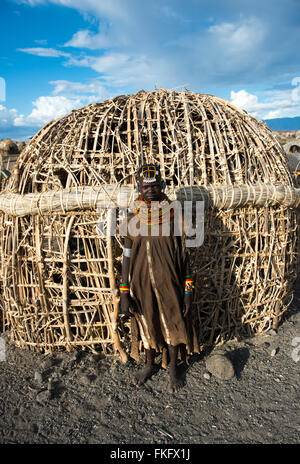 A Turkana tribal woman in her village near Lake Turkana. - Stock Photo