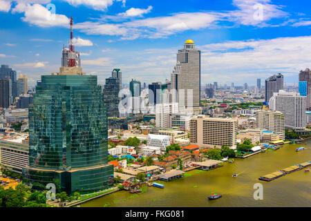 Bangkok, Thailand skyline on the Chaopraya River. - Stock Photo