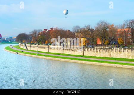 Sunny embankment of river Vistula in Krakow in the morning - Stock Photo