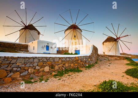 Old traditional windmills over the town of Mykonos. - Stock Photo