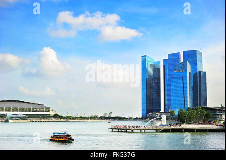Landscape with boat on a river in Downtown Core of Singapore - Stock Photo
