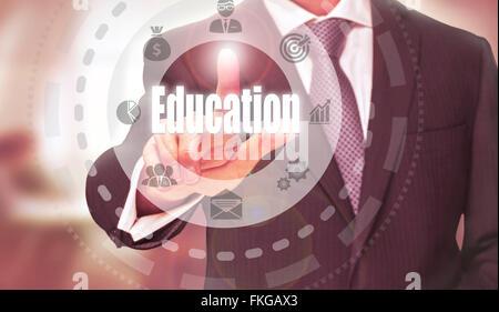 Businessman pressing an Education concept button. - Stock Photo