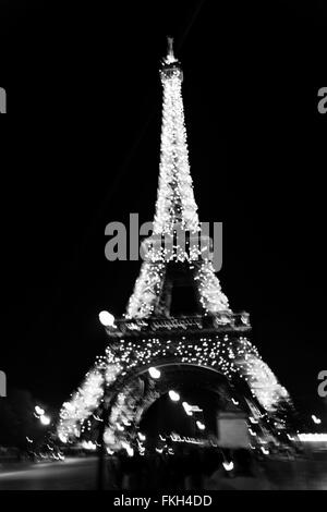 Eiffel Tower during nigthtime in Paris, France. - Stock Photo