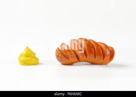 roasted sausage and mustard swirl on white background - Stock Photo
