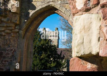 St Bartholomew's parish church seen through Moreton Corbet Castle gatehouse, Shropshire. - Stock Photo