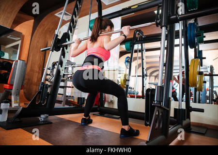 attractive woman doing leg with machine in gym  leg