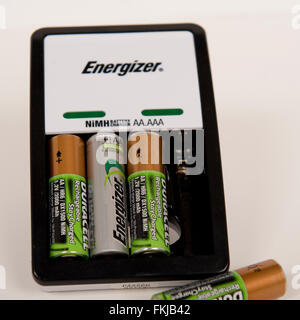 batteries and battery charger - Stock Photo