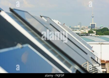rooftop panorama of Berlin_s skyline with huge solar cell panel system in the foreground, photo: 2009, June 30. - Stock Photo
