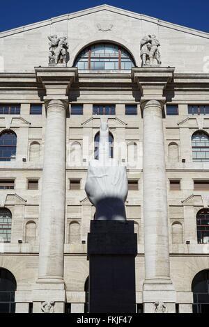 Italy: Italy's main stock exchange 'Borsa Italiana' in Milan - with statue by Maurizio Cattelan in the foreground. - Stock Photo