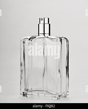 Close-up of a perfume spray bottle on gray background - Stock Photo