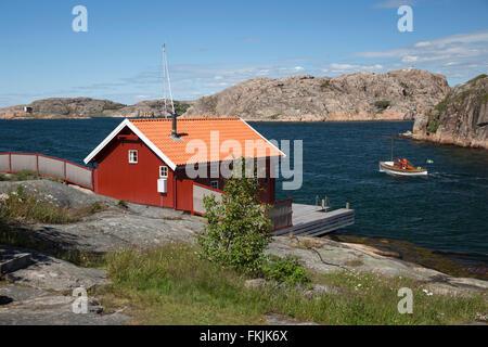 Traditional falu red house along coastline, Hamburgsund, Bohuslän Coast, Southwest Sweden, Sweden, Scandinavia, - Stock Photo