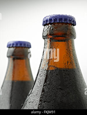A cap of beer bottle covered with water drops - Stock Photo