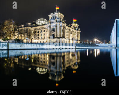 Berlin, Germany. 7th Feb, 2016. The Reichstag building, seat of the German parliament, mirrors on the calm water - Stock Photo