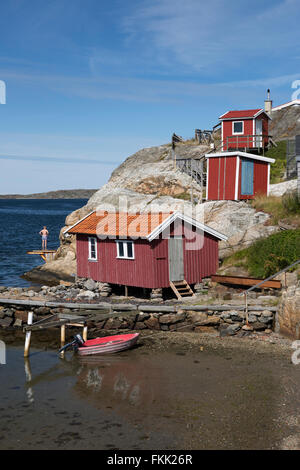 Falu red fishermen's houses on rocky coast, Ellös, Orust, Bohuslän Coast, Southwest Sweden, Sweden, Scandinavia, - Stock Photo