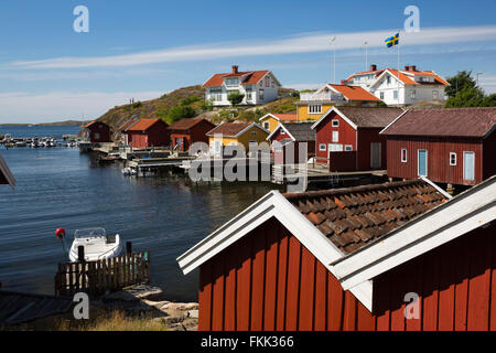 Falu red fishermen's houses in harbour, Hälleviksstrand, Orust, Bohuslän Coast, Southwest Sweden, Sweden, Scandinavia, - Stock Photo