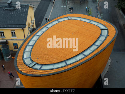 An exterior view of a modern building in Helsinki, Finland called the Kamppi Chapel of Silence. - Stock Photo