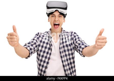 Joyful man giving two thumbs up after using a VR headset isolated on white background - Stock Photo