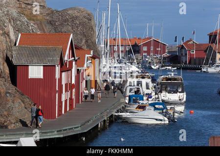 Boardwalk with falu red fishermen's houses along harbour, Smögen, Bohuslän Coast, Southwest Sweden, Sweden, Scandinavia, - Stock Photo