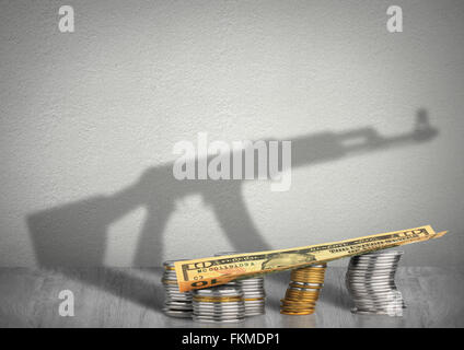 financing terrorism concept, money with weapon shadow - Stock Photo