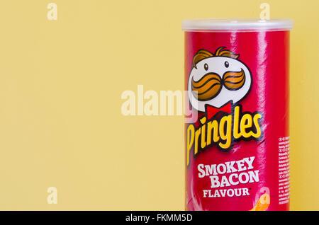 Tube of Pringles Smokey Bacon Flavour Crisps or Potato Chips - Stock Photo