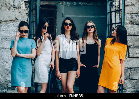 Five young beautiful girls in the city - Stock Photo