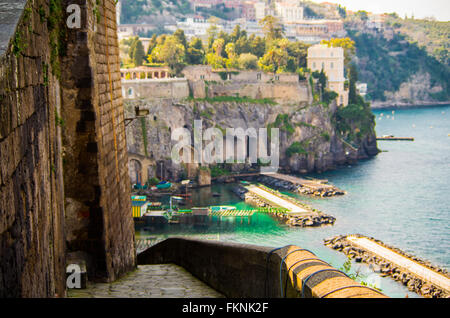 Sorrento, Naples,Italy panorama, mountain falling over blue sea and beach with boats - Stock Photo