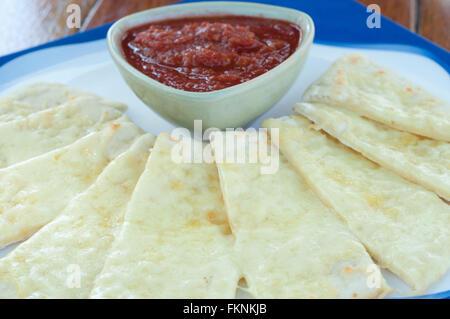 Cheese garlic bread with homemade tomato sauce. - Stock Photo