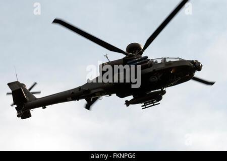 Army Air Corp apache helicopter from RAF Wattisham over Woodbridge airfield training area, Rendlesham, Suffolk, - Stock Photo