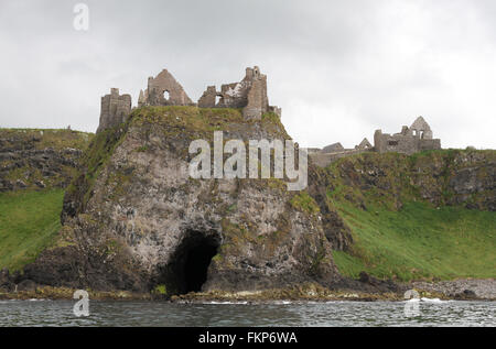 Dunluce Castle viewed from the sea. - Stock Photo