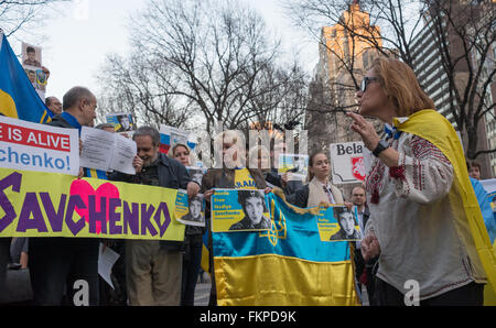 New York, United States. 09th Mar, 2016. Demonstrators hold signs and chant during the rally for Nadia Savchenko. - Stock Photo