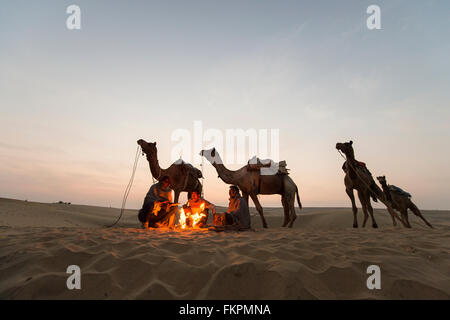 Camel Trader   in the Thar Desert during sunrise. Thar Desert located at Jaisalmer, Rajastan, - Stock Photo