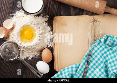 Blank vintage recipe cooking book, utensils and ingredients on wooden table. Top view with copy space - Stock Photo