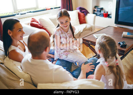 Young family spending their leisure time at home - Stock Photo